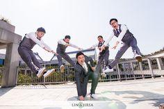 We <3 this photo to pieces. It's so fun. Groomsmen wearing purple ties and socks. White shoes, shirts and gray suits.  \\ Photo Credit: Lin & Jirsa Photography    #purplewedding #weddingphotoidea