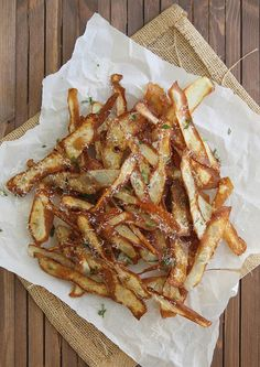 crispy potato strips, complete with grated parmesan + rosemary ~ Just used my potato peeler to make the strips. Only used one potato and it made a ton. They were awesome!