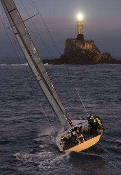 Lighthouse warns a yacht. Yacht Boat, Sail Away, Set Sail, Am Meer, Tall Ships, Water Crafts, Belle Photo, Sailing Ships, Cruise