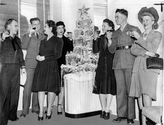 A group enjoying a Christmas party for the AWVS ( American Women's Voluntary Services). #vintage #1940s #WW2