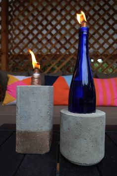 An easy step-by-step tutorial and video on how to make tabletop concrete tiki torches out of used glass bottles.