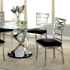 Roxo Dining Table  - CM3729T $432  Description :   Place this flowing set in any modern setting. The swirling metal base durably supports the wide, round glass top while highlighting the beautiful satin plated powder coating. Relax in style as the padded microfiber cushions offer comfort while drawing attention to the elegant back design. Contemporary Style 10Mm Tempered Glass Top Tapering Elliptical Post Table Base Ladder Back Chair Black Base & Padded Microfiber Seat Metal Frames W/