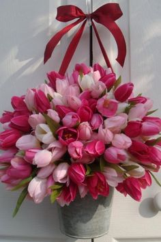 Cheerfulness is a bucket of tulips in shades of pink.