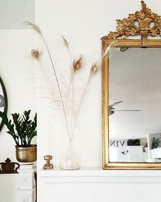 Antique gold mirror, Vintage brass candlesticks, white fireplace ...