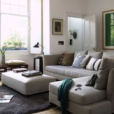 This room is an example of a neutral color scheme. It has a lot of neutral colors such as beige and brown but the designer uses a lot of different tones and tints of colors to create interest and a more fun but still clean room.
