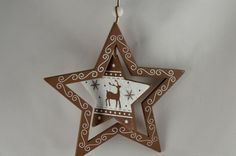 Wooden Christmas Star with Rotating Central Decoration x 1 Piece!! Xoxo  http://theribbonroom.co.uk/88032-wooden-christmas-star-with-rotating-central-decoration.html