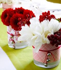 Floral fun Enliven basic glass vases with Christmas-color scrapbooking papers. Simply cut papers to fit around the vases and secure with double-sided tape. Tie red string (with silver bells attached) around the vases and insert winter bouquets. Christmas Vases, Christmas Colors, Simple Christmas, Beautiful Christmas, White Christmas, Christmas Time, Christmas Crafts, Xmas, Christmas Things