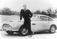 Sean Connery James Bond next to the Aston Martin DB5