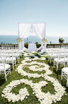 Line the aisle with swirls of rose petals to mimic the ocean's waves.   Luxury Estate Weddings & Events