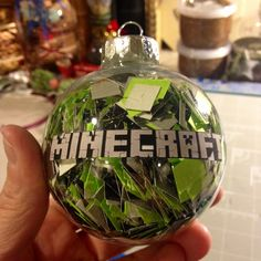 MINDCRAFT ORNAMENT- I cut up black, gray and green squares and put them inside a plastic ornament ( I got it at A c Moore - most craft stores carry them). I printed mind craft off of my computer, ran it thru my xyron sticker maker and adhered it to the front. My son and nephew are mind craft nuts - perfect Christmas present!!!! Kids Christmas Ornaments, Christmas Presents, Christmas Holidays, Christmas Decorations, Minecraft Christmas Tree, Minecraft Gifts, Minecraft Stuff, Minecraft Birthday Party, All Things Christmas