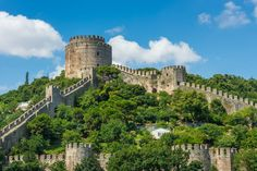 """Rumeli Fortress - Featured on RueBaRue.  Built by Sultan Mehmet II in 1452, a year before his taking of Constantinople (the ancient name for Istanbul) and a few years before he gained the moniker, """"the Conquerer,"""" the Rumeli Fortress, or Hisari, stands at the narrowest part of the Bosphorus on the European shore directly opposite the smaller Anadolu Hisari on the Asian side."""