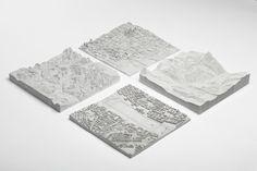 """Logiplaces (puzzles constitués de 16 à 36 pièces de béton) créés par le studio d'architecture et de design hongrois """" Planbureau """""""