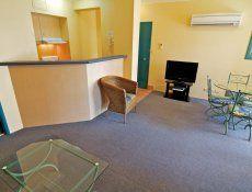 Aruba Surf Resort - Lounge/Dining Area and Kitchen - Broadbeach Family Apartments