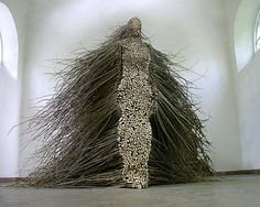 Stillness in Motion is a sculpture by Cleveland-based artist Olga Ziemska that was installed in 2003 at the Centre of Polish Sculpture in Oronsko, Poland. The piece is made entirely from cut willow branches that have been cut and stacked to create a human figure.