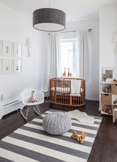 Clean, whimsical and dreamy nursery design - We love the wooden cradle!