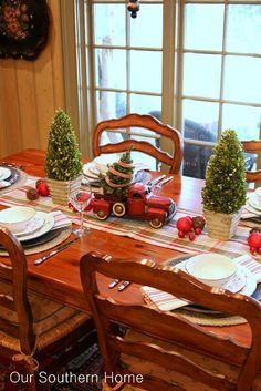Use the khaki tablecloth and use red charger plates-Welcome to a Country Christmas breakfast room by Our Southern Home.