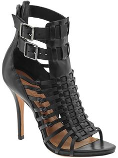 """Schutz Charley Louise Sandal High sandal Gladiator style caged straps 4"""" heel Leather lining Leather outsole Adjustable dual buckles at ankle and back zip closure Upper: 100% leather"""