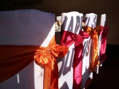 We LOVE White Spandex Covers with the Orange and Fuchsia Crinkled Taffeta Sashes! www.bayarealinens.com #party #baptism #fuchsia #orange #wedding #spandex #chaircover #bayarea #sash
