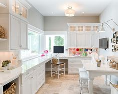 Craft Room Home Design Ideas. Love the small glass cabinets with lighting on top.