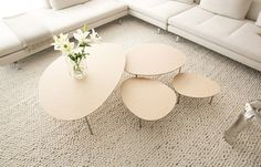 Nesting low tables with organic shapes & minimal design. Four Different sizes and finishes: white, oak, walnut or wenge.
