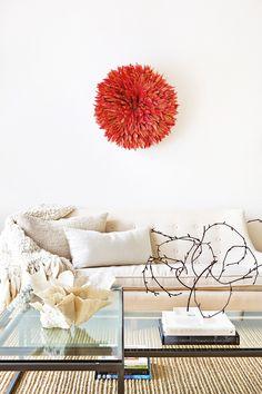 Tour a Gorgeously Layered, Artistic Hamptons Home//Juju hat, white sofa, knit blanket