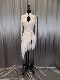 White see through fabric with white feathers and beautiful stone work.