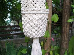 "Macramé Wall Hung Plant Hanger with oval wooden bead and wooden ring, suitable for 7.5 cm (diameter) plant pot or smaller. The hanger is made of white bleached poly cotton (cotton+polyester) twisted cord. Plant pot not included. Size: 4 ½"" Width (11.0 cm) x 27"" overall length (70.0 cm"