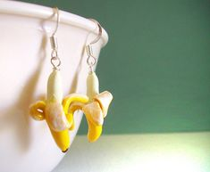 You should always take a banana to a party... Banana Earrings Kawaii Fake Food Handmade by FrostedSoSweet on etsy
