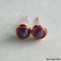 These copper stud earrings feature 6mm round Amethyst with a rubber earring back.  ૐMeasurements •6mm round Amethyst •24 gauge Copper Wire