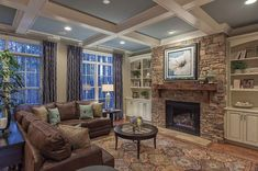 White beams contrast with a blue ceiling above a dramatic stone fireplace. New homes in the Wrenhurst community by Baker Residential in Cary, NC.