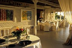 The restaurant of The Cotton House Hotel is decked out with white linen covered dinner tab...