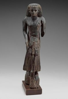 Wooden figure of a dignitary holding a statue of Osiris with stone inlays. New Kingdom. 19th dynasty. 1295–1186 B.C. | Museum of Fine Arts, Boston