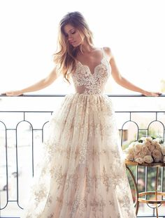 The breathtaking Lurelly Bridal collection includes sexy, form-fitting silhouettes and romantic, flowy wedding dresses — and we're obsessed!