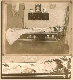Mother and baby in casket. In those times women died often while giving birth and often the newborn died too or was stillborn. So very, very sad.