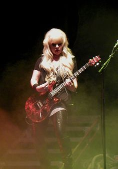 The more I learn about Australian/Greek rock guitarist Orianthi Panagaris, the more I like her... She's got mad skills on that guitar. Orianthi was named one of 12 Greatest Female Electric Guitarists by Elle magazine.[3] She also won the award as Breakthrough Guitarist of the Year 2010 by Guitar International magazine.[4]