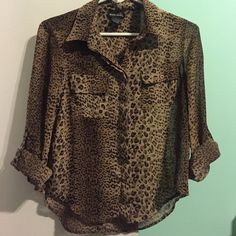 Leopard print top A sheer leopard print button up top with sleeves that can be rolled up and buttoned or left down. It has buttons going midway up the back (see second picture). The buttons on the front have a flap of material that covers them (see third picture). Wet Seal Tops Blouses
