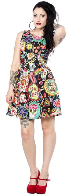 FOLTER EVOLUTION DRESS This trippy Folter Evolution Sugar Skull dress will have you smiling! This bright and colorful trippy patterned dress features a scoop neck, fitted waist, and cute keyhole opening on the back. The best feature however on this dress are the hidden pockets! $66.00 #folter #dress #sugarskulls #dayofthedead