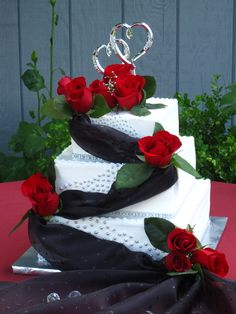 Square Wedding Cake with Red Roses, silver beads and black fabric drapes - very elegant! toptierweddingcakes.dotphoto.com