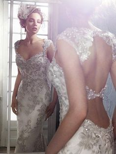 Maggie Sottero - jade, Exquisite bead embroidered lace adorns the bodice in this sheath wedding dress, with Swarovski crystal neckline. Complete with stunning double keyhole back. Finished with zipper closure.