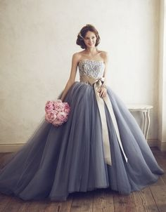 This gorgeous grey/blue wedding dress took our breath away. #uniqueweddingdresses