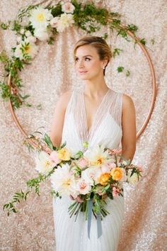 11 copper hoop with greenery and flowers as a wedding backdrop - Weddingomania
