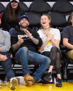Parents' night out! #AdamLevine and #BehatiPrinsloo made it a date night at the Lakers game  (Photo credit: Noel Vasquez/Getty Images)