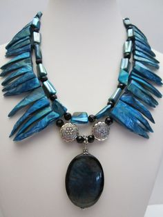 Statement necklace with turquoise shell and agate pendant, double strand.    Necklace is 17 1/2 long. plus 2 pendant drop.    Will be send in a nice box.