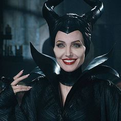 Angelina Jolie's New 'Maleficent' Trailer Debuts at the Grammys! Angelina Jolie flashes her beautiful and evil smile while playing the title character in the trailer for her new movie Maleficent. The new trailer features the… Maleficent 2014, Angelina Jolie Maleficent, Maleficent Movie, Maleficent Costume, Malificent, Angelina Jolie Gif, Maleficent Quotes, Disney Villains, Maleficent Cosplay
