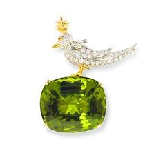 Semi precious Tiffany Peridot plus diamond bird on a rock brooch created by Jean Schlumberger