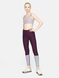Midweight legging with colorblocked ankle detail and hidden waistband pocket. Cha cha ready.