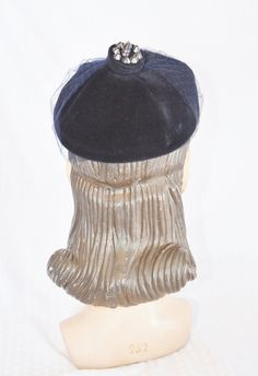 Please like my Facebook Page http://www.facebook.com/MyVintageHatShop for exclusive discounts and promotions.    Unusual vintage hat from the