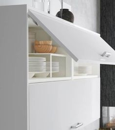 The IKEA SEKTION wall cabinet with RINGHULT doors is sleek and stores everything within reach in the kitchen.