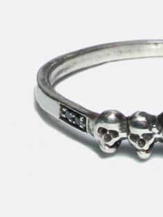 MACHA: Skull ring, sterling silver with diamonds. The quaintest, most delicate skull ring with just a hint of darkness. Set with 4 tiny black diamonds. $195  Rock n Roll, Statement jewelry, fashion jewelry, custom, unique jewellery.