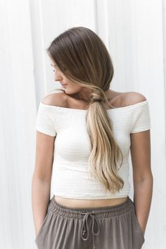 """Stretchy off-shoulder crop top made with smocked jersey knit fabric. Size small total length measures approx. 13"""". Available in Teal, Black, or White. - 95% Rayon 5% Spandex - Imported"""